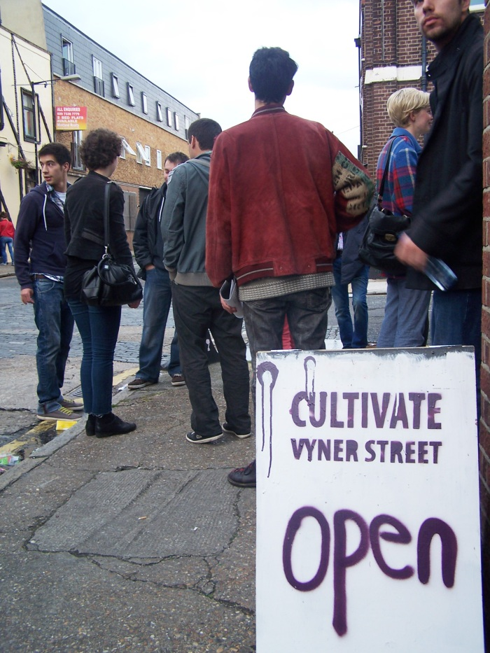 the  open sign outside Cultivate....