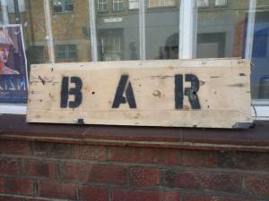 The untainted bar sign before it was painted on.