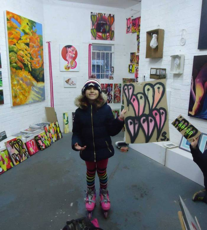 A satisfied visitor to Cultivate Evolved with a Sean Worrall piece
